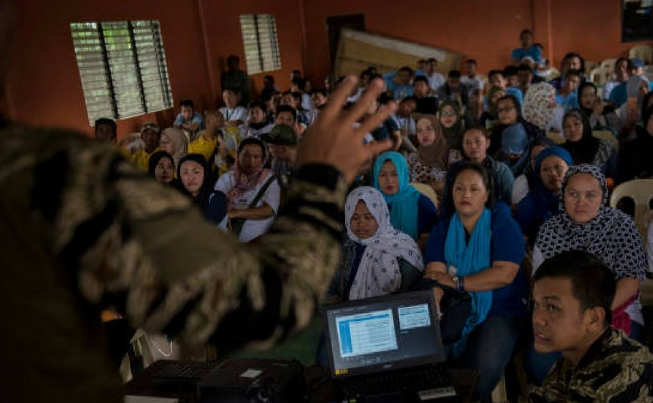 """""""We now announce the termination of all combat operations in Marawi,"""" said the defence secretary of Philippines Delfin Lorenzana on the sidelines of regional security meeting in Clark. Getty Images"""