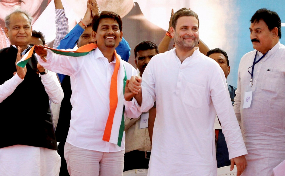 Congress vice-president Rahul Gandhi with the OBC leader Alpesh Thakor who joined the party, during a public meeting in Gandhinagar, Gujarat on Monday. PTI