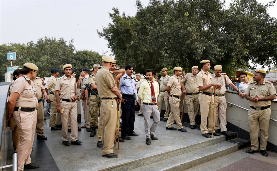 """Police and security personnel deployed at an entrance gate of Rajiv Chowk Metro Station during the launch of Delhi Congress committee's weeek-long """" Kejriwal+BJP, Stop Politics, Save Metro"""" campaign in New Delhi on Wednesday. PTI"""