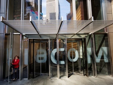 A woman exits the Viacom Inc. headquarters in New York. Reuters.