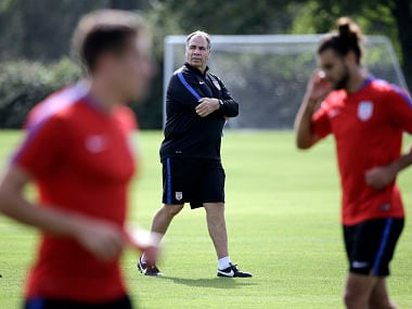 United States head coach Bruce Arena, center, watches players go through drills during a soccer training session, Monday, Oct. 2, 2017, in Sanford, Fla. The United States hosts Panama in a World Cup qualifying match on Friday, Oct. 6. (AP Photo/John Raoux)