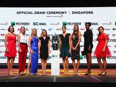 SINGAPORE - OCTOBER 20:  (L-R) Caroline Garcia of France, Caroline Wozniacki of Denmark, Elina Svitolina of Ukraine, Simona Halep of Romania, Garbine Muguruza of Spain, Karolina Pliskova of Czech Republic, Venus Williams of the United States and Jelena Ostapenko of Latvia pose during the Official Draw Ceremony and Gala of the BNP Paribas WTA Finals Singapore presented by SC Global at Marina Bay Sands Hotel on October 20, 2017 in Singapore.  (Photo by Clive Brunskill/Getty Images for WTA)