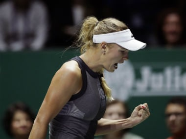 Caroline Wozniacki celebrates after beating Karolina Pliskova during their singles semifinal at WTA Finals. AP