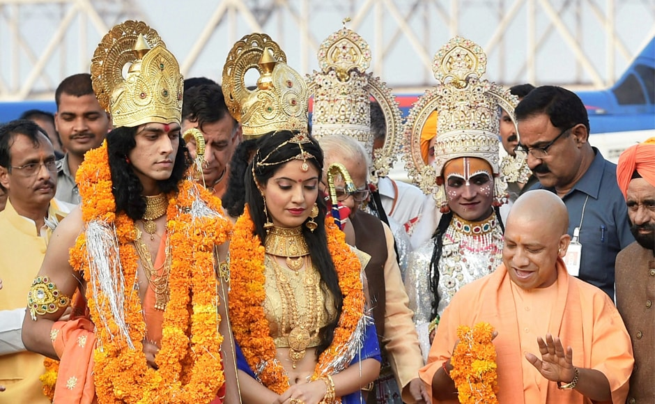 Yogi Adityanath with artists dressed as characters fromthe Ramayana. The chief minister also said he was trying to bring Ayodhya on the world tourist map by ensuring all-round development. PTI