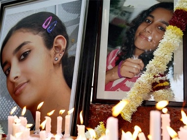 Friends and relatives of Aarushi Talwar light candles near her portrait. PTI