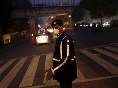 File image of a traffic policeman wearing a mask to protect himself from dust and air pollution as he signals to drivers in New Delhi. Reuters