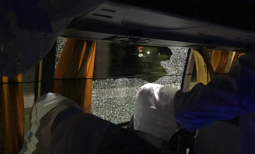 This photo tweeted by Australian batsman Aaron Finch shows the broken glass of one of the windows of the Australian team bus in Guwahati. Twitter/ @AaronFinch5