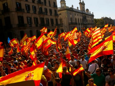 People wave Spanish and Catalan flags during a march in downtown Barcelona, Spain, to protest the Catalan government's push for secession from the rest of Spain, on Sunday. AP