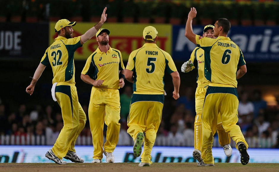 Australia pacer Nathan Coulter-Nile struck early to see the back of Rohit Sharma for 11. AP