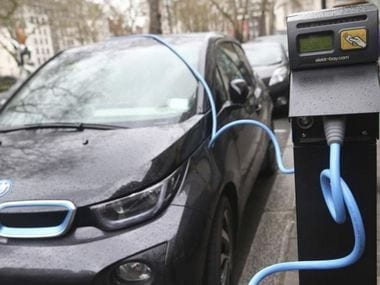 Electric car charging at a station in UK. Reuters