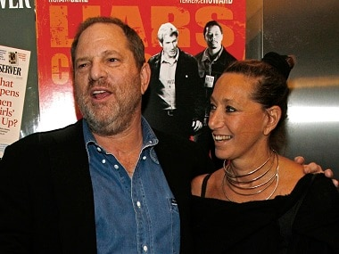 """CORRECTS DATE TO MONDAY, OCT. 9 FROM MONDAY, OCT. 10 - FILE - In this Aug. 22, 2007, file photo, Harvey Weinstein and Donna Karan arrive at the premiere of """"The Hunting Party"""" at the Paris Theater in New York. Karan apologized on Monday, Oct. 9, 2017, after offering praise for Weinstein the night before following his firing from his company amid allegations of sexual harassment lasting decades. (AP Photo/Rick Maiman, File)"""