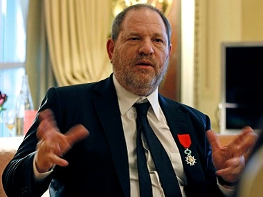 FILE - In this March 7, 2012 file photo, U.S film producer and movie studio chairman Harvey Weinstein during an interview with the Associated Press in Paris, the same day as Weinstein received, Chevalier of the Legion of Honor by French President Nicolas Sarkozy. French President Emmanuel Macron says Sunday Oct. 15, 2017 that he wants to revoke Harvey Weinstein's Legion of Honor award after the wave of accusations of sexual harassment and abuse against the Hollywood titan. (AP Photo/Remy de la Mauviniere, File)