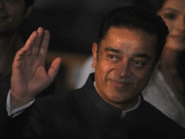 Indian actor Kamal Haasan waves at fans as he arrives at the green carpet to attend the premier of the new movie 'Shanghai' during the International Indian Film Academy (IIFA) awards event, in Singapore on June 7, 2012. Bollywood actors are in Singapore to attend the three-day International Indian Film Academy (IIFA) awards that begins on June 7.   AFP PHOTO/ Punit PARANJPE