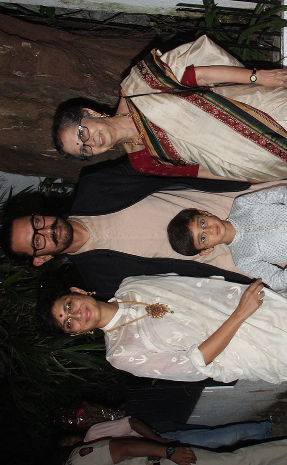 Kiran Rao and Aamir Khan hosted a Diwali party on Thursday night for close friends from the film fraternity. Here, the couple poses for photographers along with their son, Azad. Photo: Sachin Gokhale/Firstpost