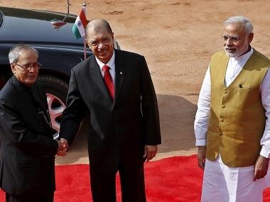 Former Seychelles' president James Michel with former president Pranab Mukherjee and Prime Minister Narendra Modi. Reuters