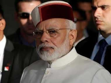 Prime Minister Narendra Modi donning the Himachali cap during his visit to Israel. Reuters