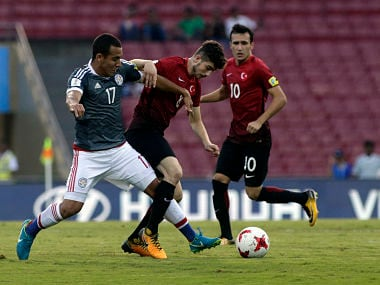 Turkey's player Egehan Gok duels for the ball against Paraguay's Stevens Gomez during the FIFA U-17 World Cup match in Mumbai. AP