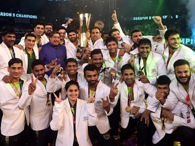 Players of Patna Pirates pose with the winners trophy after their win over Gujarat Fortune Giants in the Vivo Pro Kabaddi final. AP