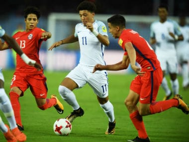 Chile players struggle to contain England's Jadon Sancho (C) in a FIFA U-17 World Cup match in Kolkata. AFP