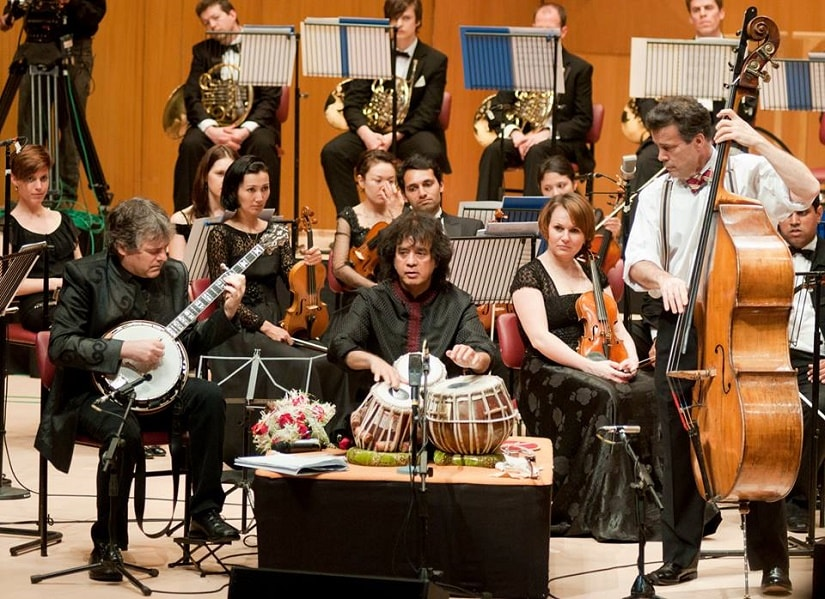 Zakir Hussain performs with the Symphony Orchestra of India. Image from Faceook/soimumbai