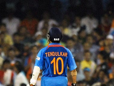 Indian batsman Sachin Tendulkar walks back to the pavilion after being dismissed during the quarter-final match of The ICC Cricket World Cup 2011 between India and Australia at The Sardar Patel Stadium, Motera in Ahmedabad on March 24, 2011. AFP PHOTO/Indranil MUKHERJEE / AFP PHOTO / INDRANIL MUKHERJEE