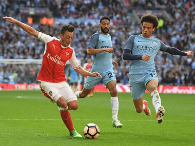 Arsenal's German midfielder Mesut Ozil (L) vies with Manchester City's German midfielder Leroy Sane (R) during the FA Cup semi-final football match between Arsenal and Manchester City at Wembley stadium in London on April 23, 2017. / AFP PHOTO / Justin TALLIS / NOT FOR MARKETING OR ADVERTISING USE / RESTRICTED TO EDITORIAL USE