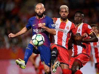 Barcelona's defender from Argentina Javier Mascherano (L) vies with Girona's defender Jonas Ramalho (C) and Girona's Kenyan forward Michael Olunga during the Spanish league football match Girona FC vs FC Barcelona at the Montilivi stadium in Girona on September 23, 2017. / AFP PHOTO / Josep LAGO