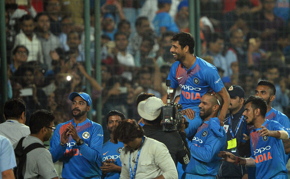 Indian cricket team players carried Nehraji as he took a lap of honour around his home ground as one of India's longest-serving players bade farewell to cricket. AFP