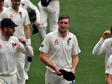 England's paceman Craig Overton (C) walks off the field with teammates following their victory against Cricket Australia XI on the last day of a four-day Ashes tour match at Adelaide Oval in Adelaide on November 11, 2017. / AFP PHOTO / SAEED KHAN / IMAGE RESTRICTED TO EDITORIAL USE - STRICTLY NO COMMERCIAL USE