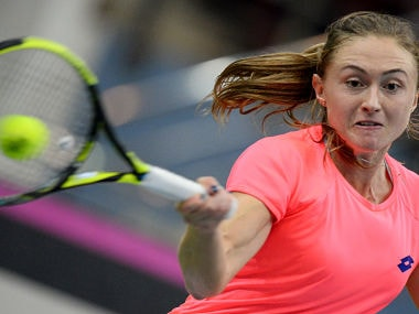 Belarus' Aliaksandra Sasnovich returns to Sloane Stephens of USA during their Fed Cup final tennis match. AFP