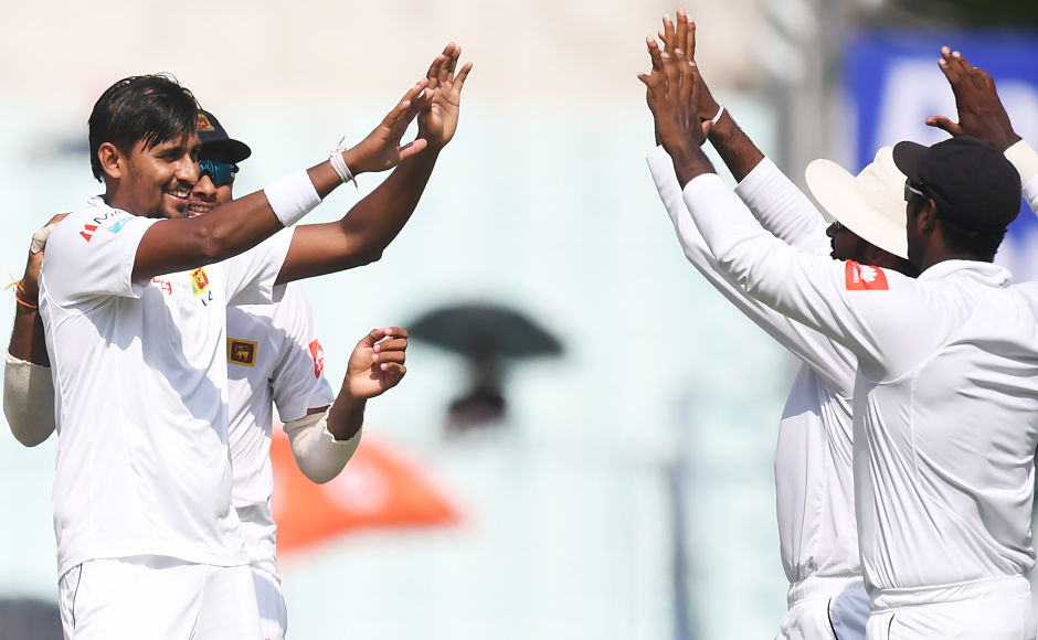 Sri Lanka's Suranga Lakmal (L) celebrates the wicket of India's Bhuvneshwar Kumar. At one stage, it was looking tough for India to cross the 150-run mark but the lower order came up fine against the Lankans. The host team were finally bowled out for 172. AFP