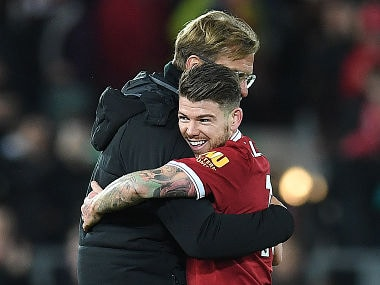 Liverpool's German manager Jurgen Klopp hugs Liverpool's Spanish defender Alberto Moreno following the English Premier League football match between Liverpool and Southampton at Anfield in Liverpool, north west England on November 18, 2017. / AFP PHOTO / Paul ELLIS / RESTRICTED TO EDITORIAL USE. No use with unauthorized audio, video, data, fixture lists, club/league logos or 'live' services. Online in-match use limited to 75 images, no video emulation. No use in betting, games or single club/league/player publications. /