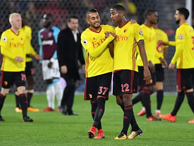 Watford's Argentinian midfielder Roberto Pereyra (L) shakes hands with Watford's Dutch midfielder Marvin Zeegelaar (R) at the end of the English Premier League football match between Watford and West Ham United at Vicarage Road Stadium in Watford, north of London on November 19, 2017. / AFP PHOTO / Ben STANSALL / RESTRICTED TO EDITORIAL USE. No use with unauthorized audio, video, data, fixture lists, club/league logos or 'live' services. Online in-match use limited to 75 images, no video emulation. No use in betting, games or single club/league/player publications. /