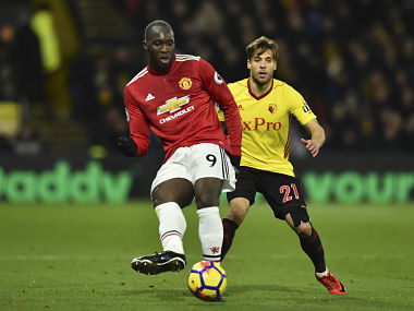 Manchester United's Belgian striker Romelu Lukaku (L) plays the ball away from Watford's Spanish defender Kiko Femenia (R) during the English Premier League football match between Watford and Manchester United at Vicarage Road Stadium in Watford, north of London on November 28, 2017. / AFP PHOTO / Glyn KIRK / RESTRICTED TO EDITORIAL USE. No use with unauthorized audio, video, data, fixture lists, club/league logos or 'live' services. Online in-match use limited to 75 images, no video emulation. No use in betting, games or single club/league/player publications. /