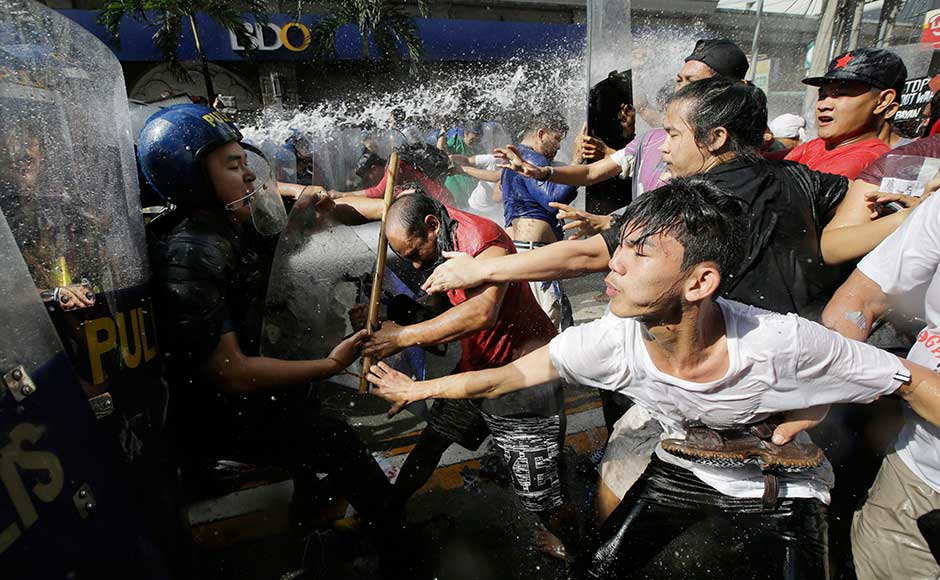 Riot police used water cannons to prevent hundreds of protesters reaching the US embassy in Manila on Sunday, just a few hours before the arrival of US president Donald Trump in the Philippines for a regional summit and the last leg of his Asia tour. AP