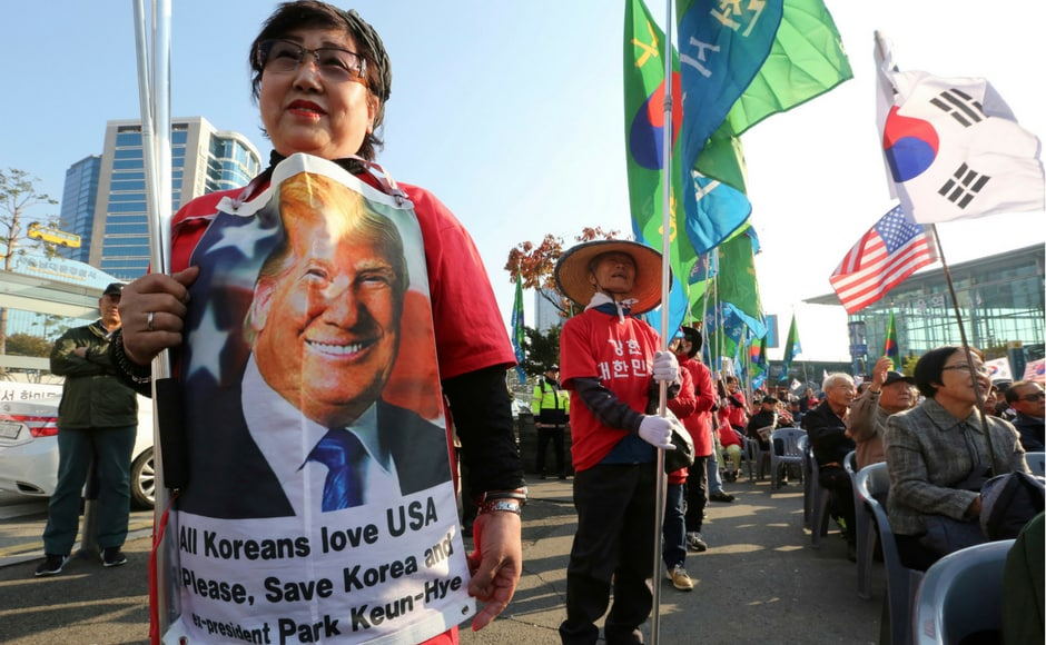 The pro-Trump supporters, some of whom were wearing military uniforms, urged Washington to help South Korea. AP