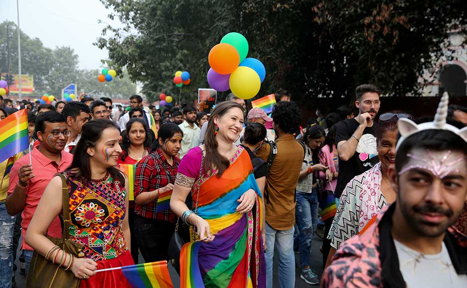 As people chanted and marched to the beat of drums during New Delhi's 10th annual Queer Pride march, many said they were frustrated with the law but also hoped it would soon change. A participant wears a saree with colours of the rainbow. AP