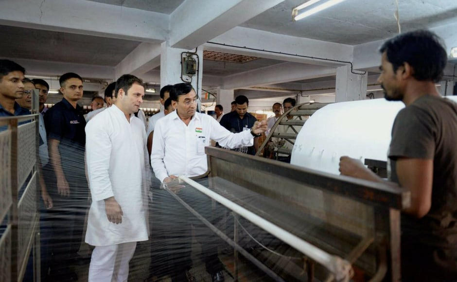 Rahul Gandhi visited workers and industry representatives of a textile factory in Surat on Wednesday in poll-bound Gujarat. PTI