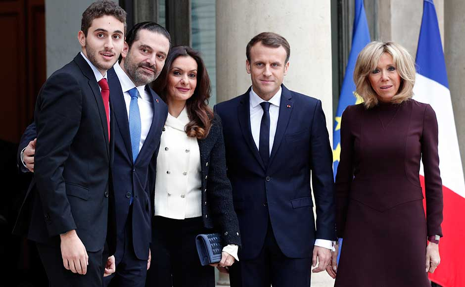 """The Lebanese leader's wife and elder son were to join them for the meal after the talks, but the couple's two younger children remain in Riyadh """"for their school exams"""", a source close to Hariri said. Macron, centre right and his wife Brigitte greet Hariri, his wife Lara and their son Hussam upon their arrival. AP"""