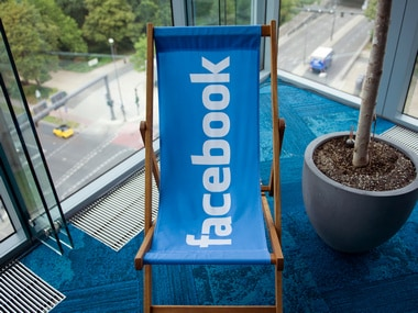 A picture shows the Facebook logo on a chiar in the cpmpany's Berlin office. Reuters