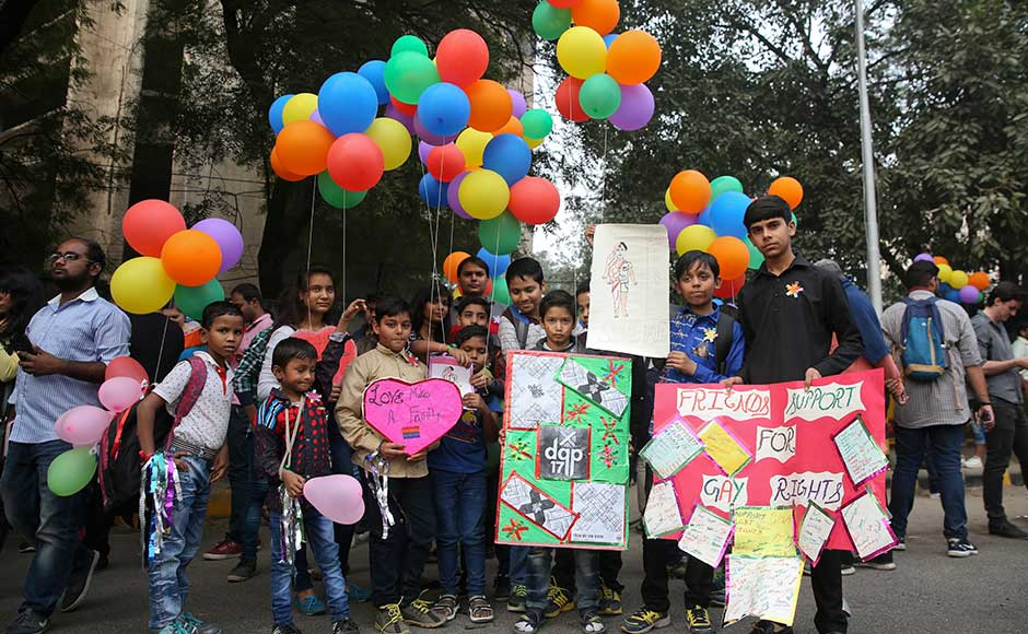 Indian law makes gay sex punishable by up to 10 years in prison. Matiyani said the law is often used by the police and community members to threaten people or extort money from them. Children hold colourful balloons and placards in support of gay rights. AP