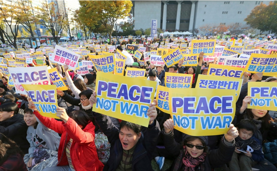 This shows the widening gap in the Korean society where some believe that only peace can resolve the conflict while others are open to considering the military option. AP