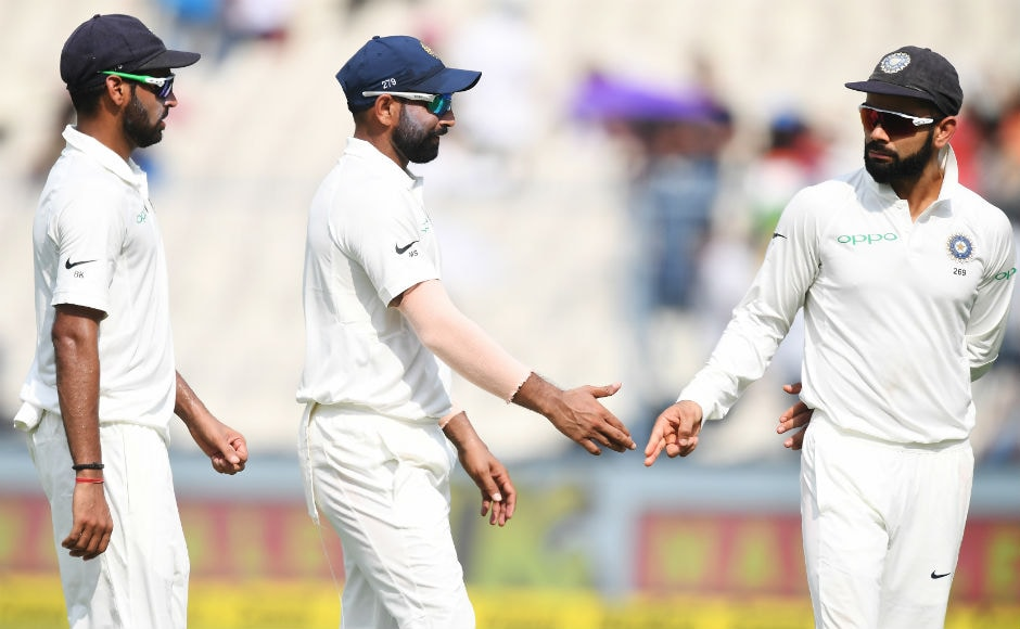 Both Bhuvneshwar Kumar and Mohammed Shami ended withfour wickets each as Sri Lanka took a 122-run lead. Here, captain Kohli congratulates both the pacers after they wrapped Lanka's innings. AFP