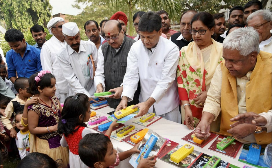 In Bihar, books and other stationery items were distributed to slum children. PTI
