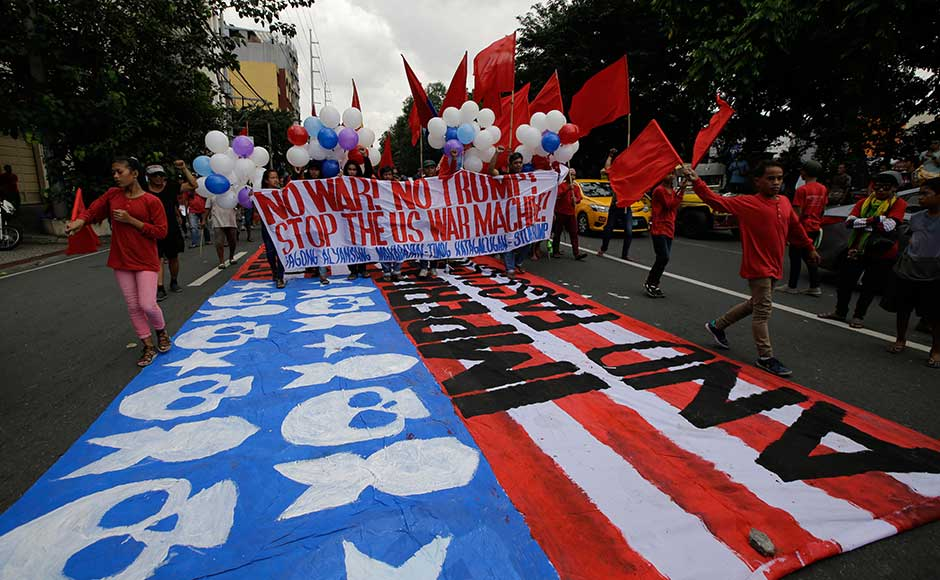 Trump will meet Philippine President Rodrigo Duterte in Manila, where he will try to shore up relations strained by the mercurial Duterte's notorious anti-US sentiment and his enthusiasm for better ties with Russia and China. Protesters walk on a giant mock US flag during a rally near the venue of ASEAN summit and meetings in Manila. AP