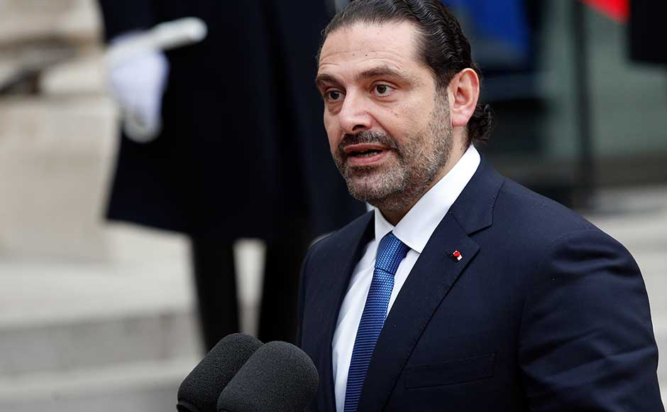 Aoun said on Saturday that he had spoken by telephone to the premier after his arrival in Paris, and that Hariri said he would be back in Lebanon for Independence Day celebrations on Wednesday. Hariri speaks to reporters after a lunch with Macron. AP
