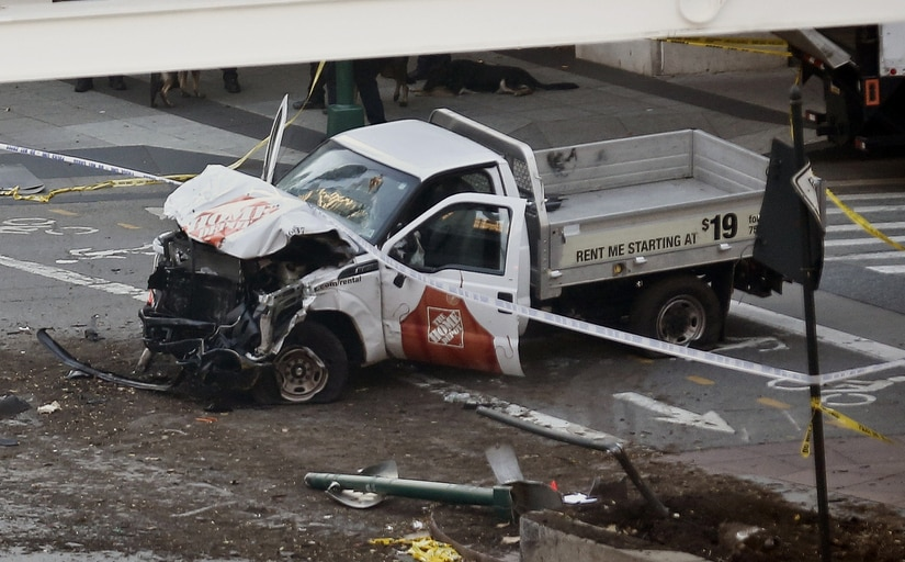 Police tape rests on a damaged Home Depot truck sits after a motorist drove onto a bike path near the World Trade Center memorial, striking and killing several people Tuesday/ AP