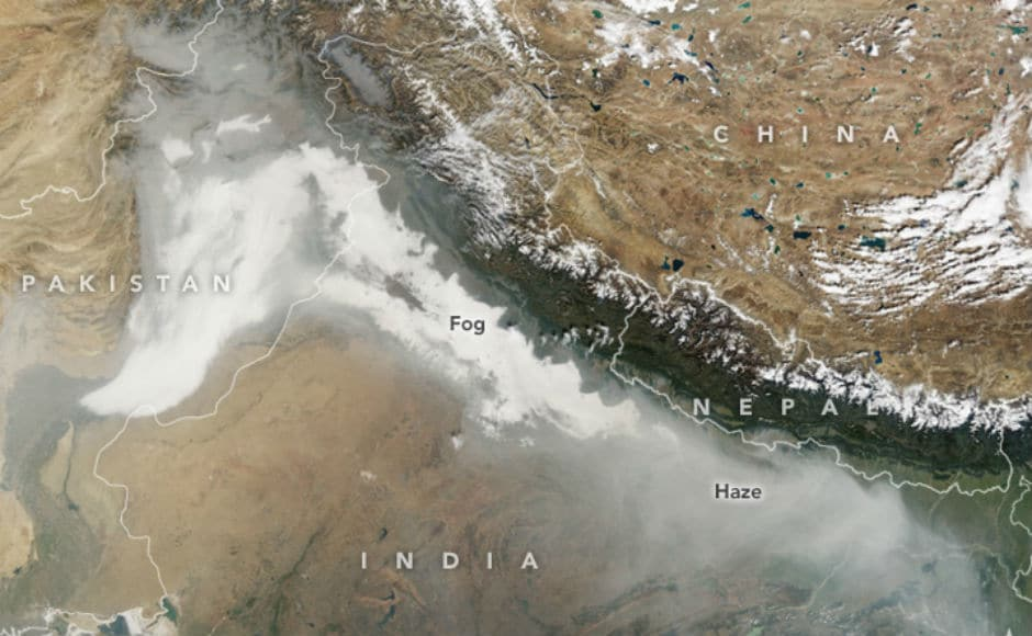 Delhi continued to witness high pollution levels on Friday, as thick smog covered the city. NASA released images showing the extent of smog and fog enveloping northern Indiaand parts of Pakistan. Image courtesy: earthobservatory.nasa.gov