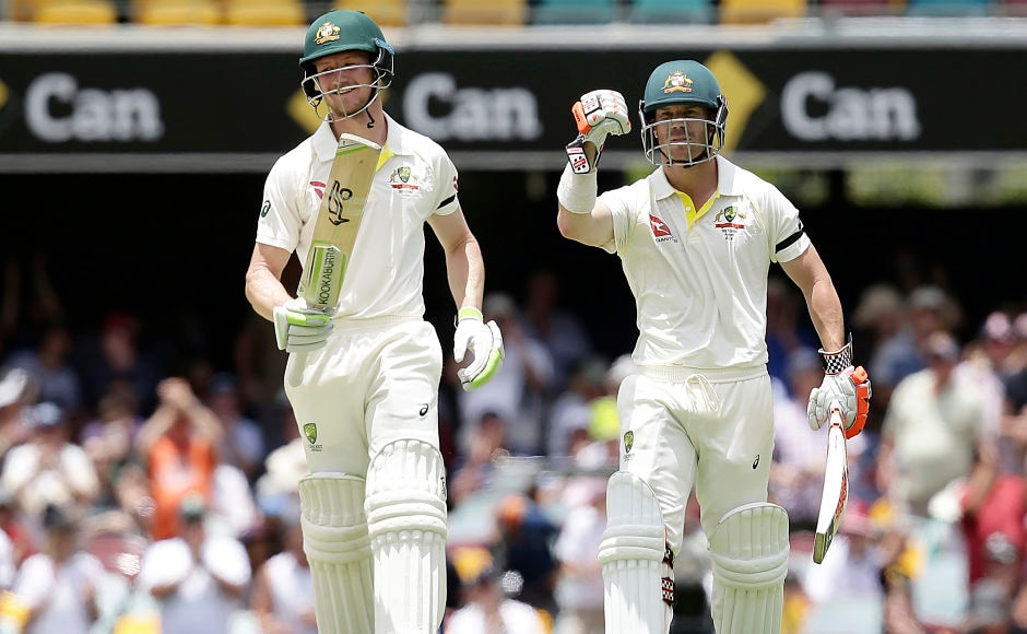 David Warner, right, pumps his fist, after and he and his opening partner Cameron Bancroft took Australia to a 10-wicket victory over England in the first Ashes Test at the Gabba in Brisbane, Australia. AP