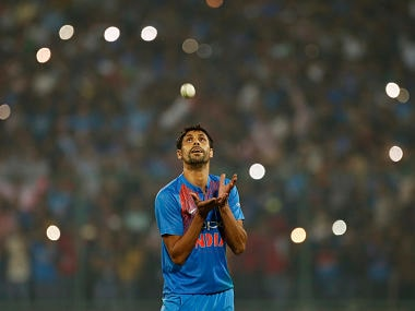 India's Ashish Nehra catches the ball as he prepares to bowl his final over in his last international cricket match, during the first Twenty20 match against New Zealand in New Delhi, India, Wednesday, Nov. 1, 2017. (AP Photo/Altaf Qadri)